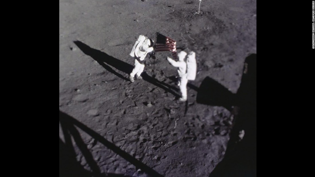 Armstrong and Aldrin place the American flag on the moon. This image was captured by the Apollo 11 data acquisition camera that was mounted to the lunar module Eagle.