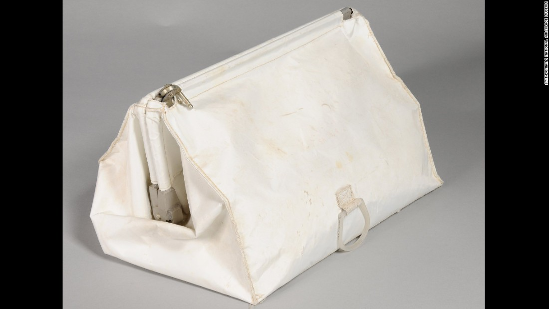 This bag, also known as a McDivitt purse, was stowed in the lunar module during Apollo 11. Carol Armstrong found the purse in a closet and donated it and its contents to the Air and Space Museum.