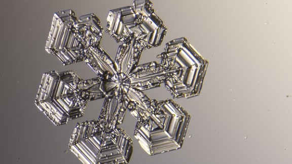 Michael Peres has been photographing snowflakes under a microscope for 13 years. Every time it snows in Rochester, New York, he runs outside, ready to photograph the tiny flakes.