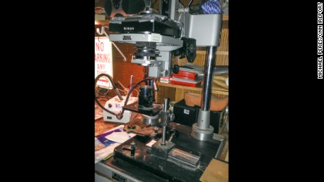 Peres attached his camera lens to a bellows atop a microscope in this homemade set-up.