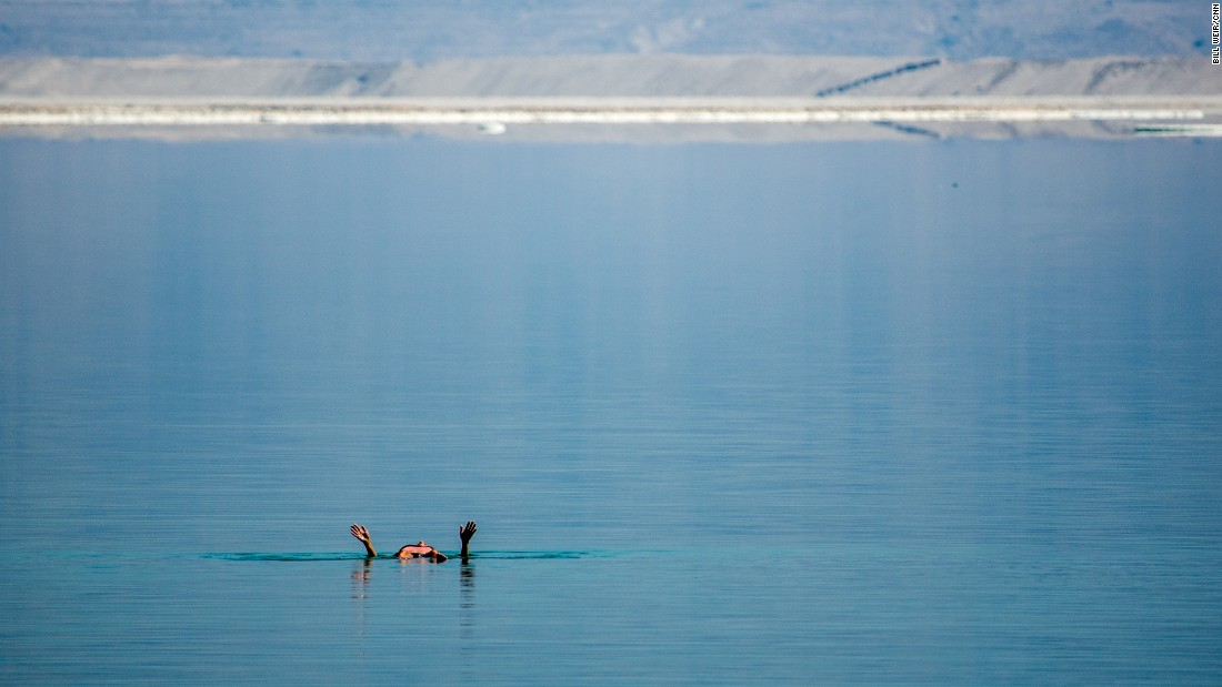 A visitor to the DMZ Medical Spa in southern Israel floats in the evaporation ponds of the Dead Sea.