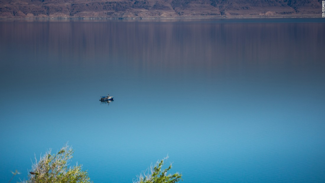 A lone ship navigates the still waters of the Dead Sea near Ein Fasha.
