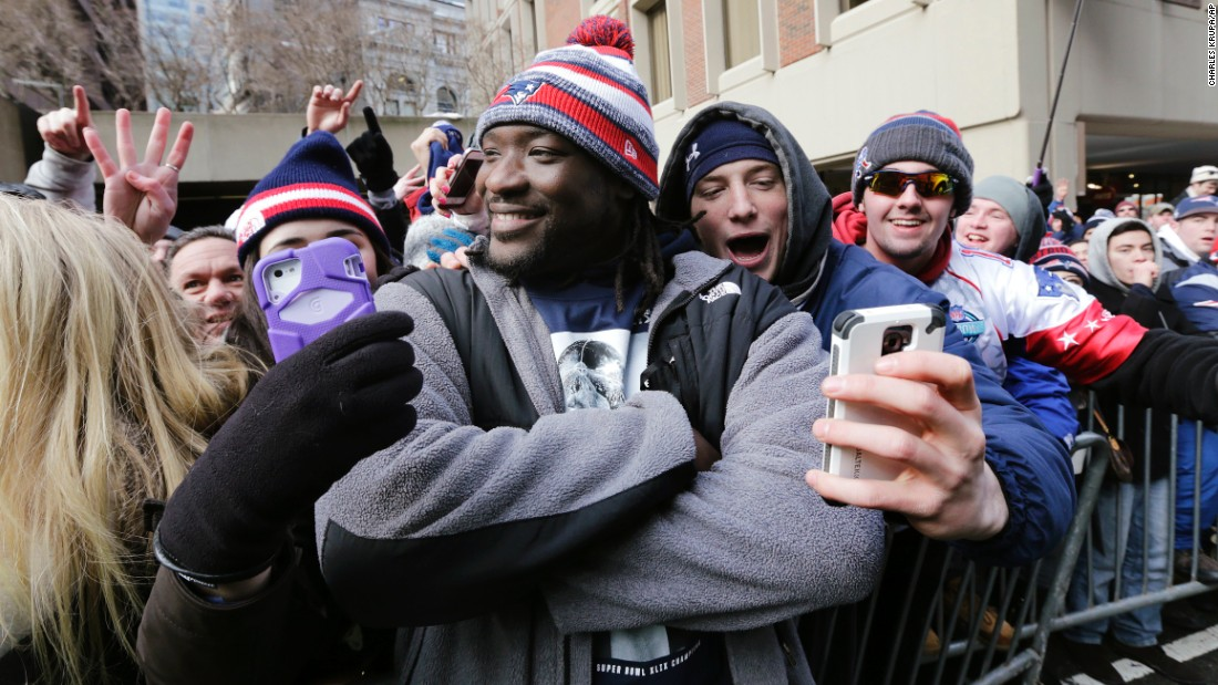 "New England Patriots running back LeGarrette Blount smiles for fans during the team's <a href=""http://www.cnn.com/2015/02/01/us/gallery/super-bowl-xlix/index.html"" target=""_blank"">Super Bowl</a> victory parade Wednesday, February 4, in Boston."