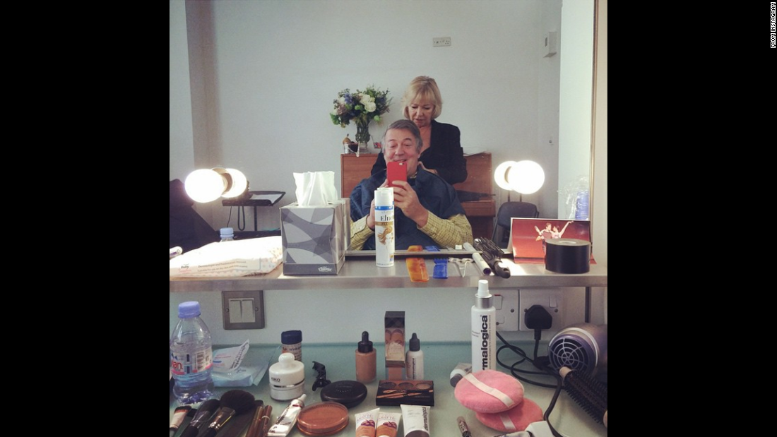 "Actor Stephen Fry gets ready for the BAFTA Awards on Sunday, February 8. ""My beloved @SueSianMakeUp trying to make a silk purse out a sow's ear,"" <a href=""http://instagram.com/p/y2HSK6MyT9/?modal=true"" target=""_blank"">he joked on Instagram.</a>"