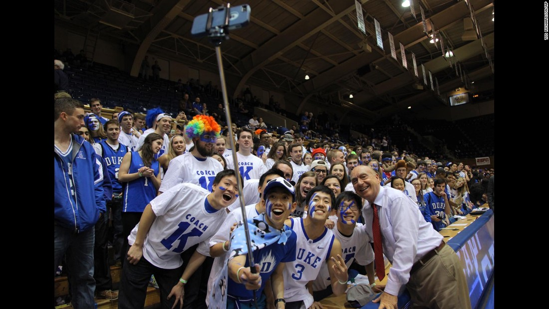 "Sports commentator Dick Vitale mixes it up with the ""Cameron Crazies"" before a Duke basketball game Wednesday, February 4, in Durham, North Carolina."