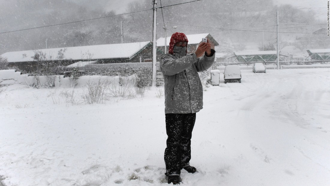 A man takes a selfie Wednesday, February 4, during a snowstorm in the Spanish village of Puente de los Fierros.