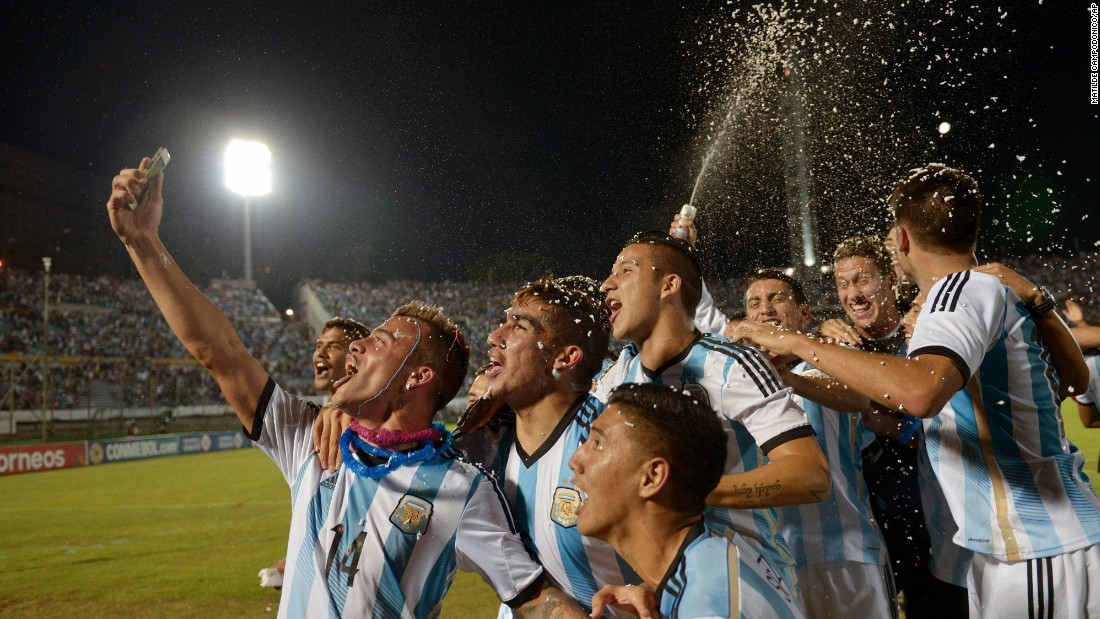 Soccer players with Argentina's under-20 team take a selfie while they celebrate winning the South America under-20 championship on Sunday, February 8.