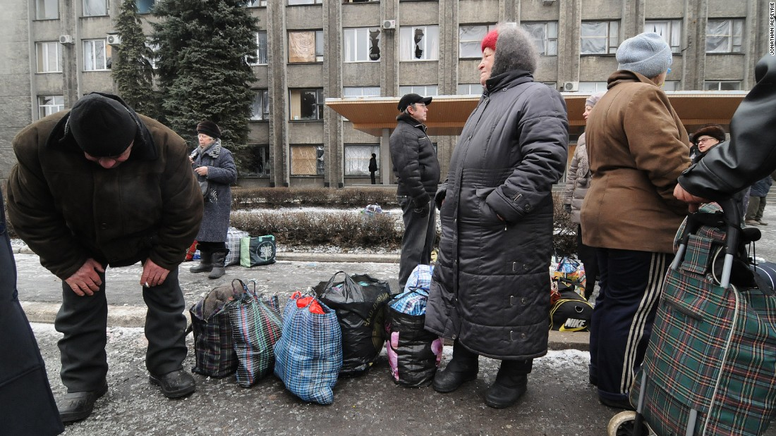 "Locals wait in line for buses that will get them out of harm's way. ""The city infrastructure is increasingly devastated,"" said a spokesman for the Ukrainian military."