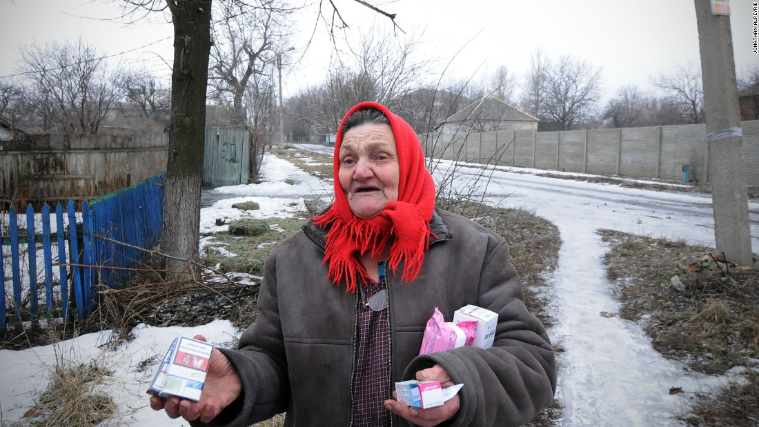 An elderly woman received medications from volunteers who go around the town providing supplies to the 3,000 remaining Debaltseve civilians in the area. Some seniors are so old they remember the horrors of World War II, such as a woman who stayed inside her apartment for two weeks, simply lying on her bed.