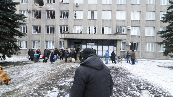 The City Hall was targeted by separatist forces shelling the center of town February 9, 2015, Debalteve, Donbass Oblast, Ukraine..The battle of the railway hub of Debaltseve has reached a breaking point. Only an estimated 3 thousand locals are still present within the city out of its original 25 thousand. Pro-Russian forces have been attempting to encircle the city from the North, shelling heavily the area while making slow progress towards their goal. Each day a few volunteers drive back and forth between Artemovsk and the besieged city to deliver supplies to locals while driving back whomever wants out of the war zone.
