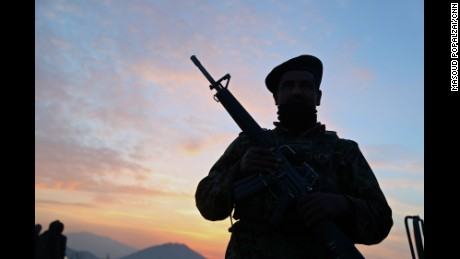 Silhouette of an Afghan National Army soldier while on duty guarding a high hill in Kabul city.