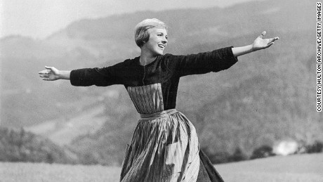 1965: British singer and actress Julie Andrews twirls while singing on top of a mountain in the opening scene of director Robert Wise's film, 'The Sound of Music'.