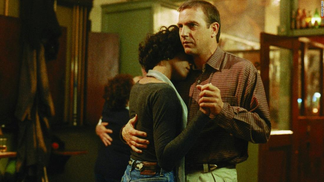 "Houston dances with Kevin Costner in a scene from the 1992 film ""The Bodyguard."""
