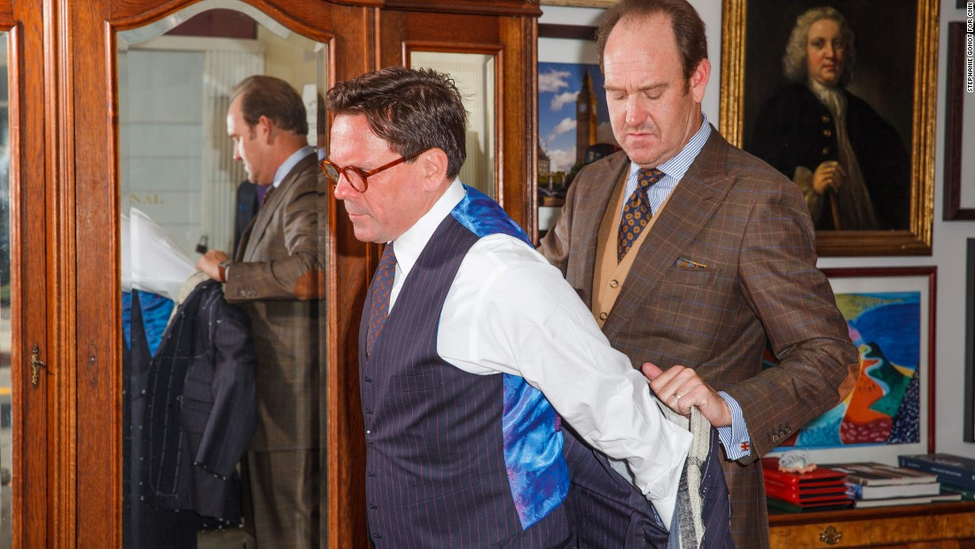Behr, right, has been in business for 30 years, making suits in the style of London's Savile Row master tailors. Well-heeled clients visit Behr's showroom for the customary four-step process of building a bespoke suit. Here, he fits his business partner Jeffery Plansker for a suit.