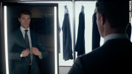 Jamie Dornan as Christian Grey dons one of many custom-made suits.