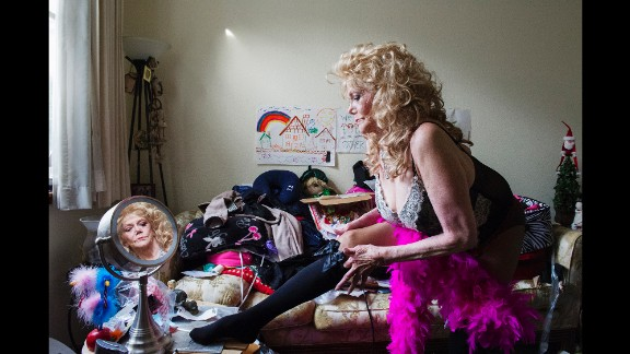 Ellion Ness gets dressed in San Francisco in 2012. Burlesque is known for its elaborate costumes and routines.
