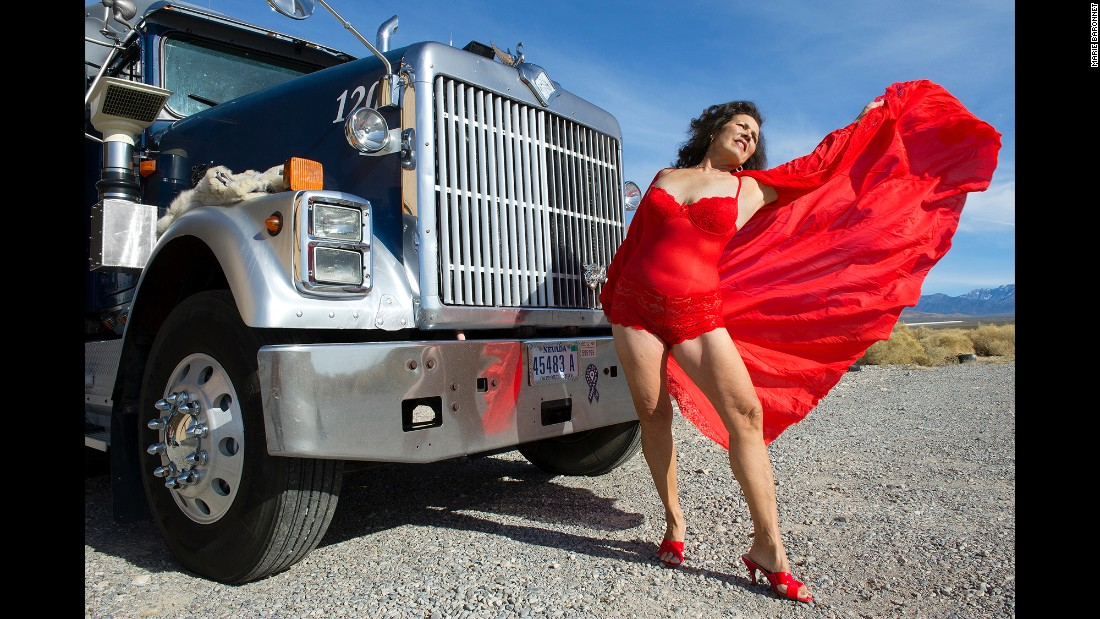 Angel Carter poses with a massive truck in Pahrump, Nevada, in 2012.