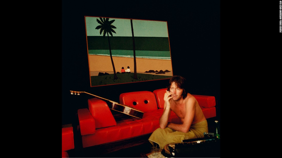 """I took this shot while on my first tour of America with Eric and his band. This was just one of the hotels we stayed in. I particularly liked the hideous red frame of the picture on the wall matching the sofa and the small figure in the painting,"" Boyd said."