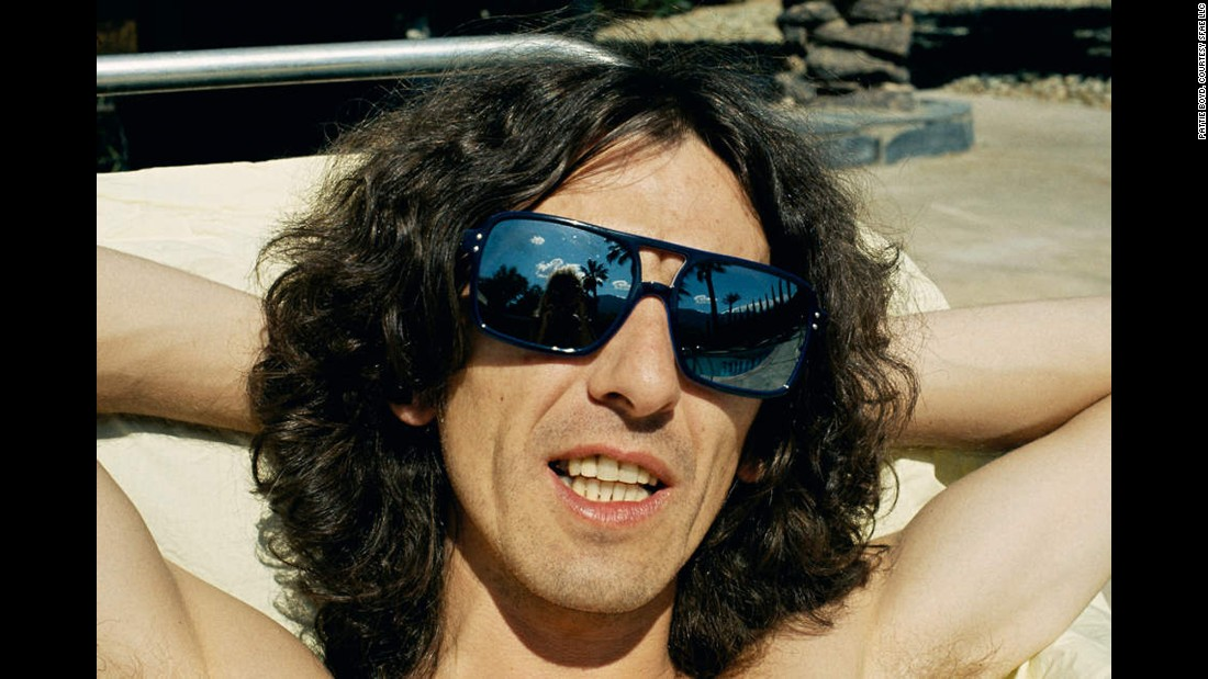 "Harrison is captured sunbathing in Palm Springs during a quick holiday break he and Boyd took together in the California desert resort town between recording sessions in Los Angeles. This was near the time of the ""Living in the Material World"" album cover shoot in Los Angeles."