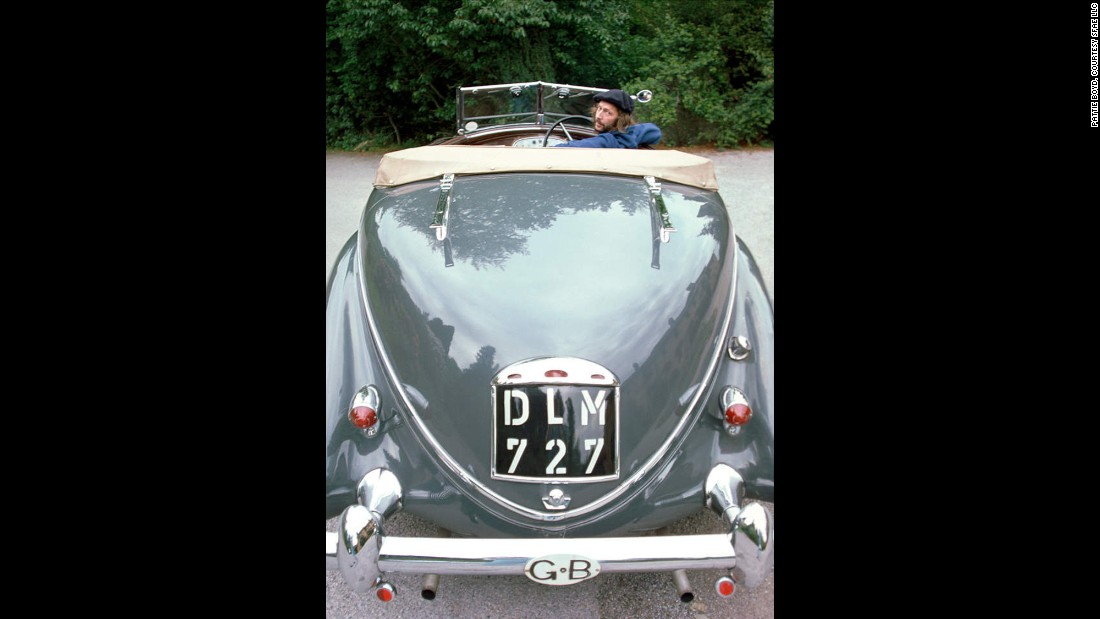 An avid car collector, Clapton is captured here deciding to buy a 1930s-era green Lancia Astura.