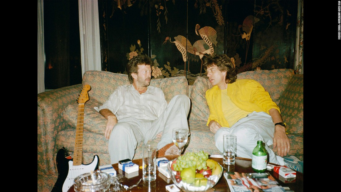 Clapton and Mick Jagger chat backstage on a couch at Philadelphia's JFK Stadium before the Live Aid concert.