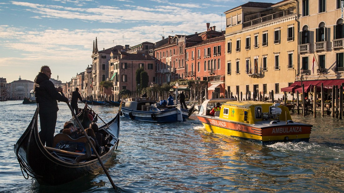 A gondolier takes some tourists out on an early morning punt along the Grand Canal.
