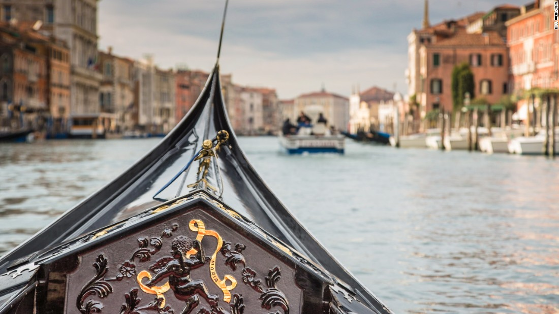 The bow of champion gondolier Giampaolo D'Este's gondola, cutting its way through the Grand Canal.