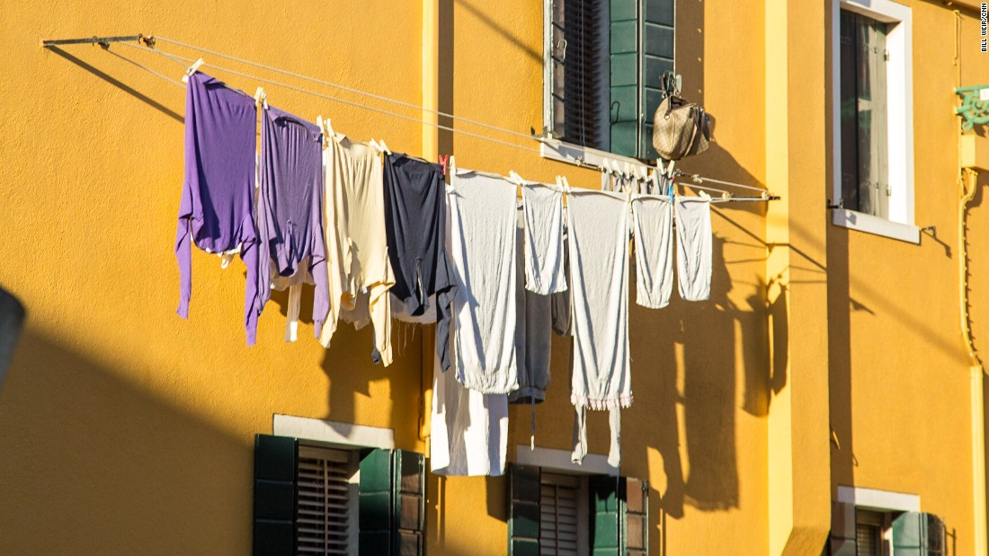 Clothes hang above the alleyways on the Venetian island of Burano.