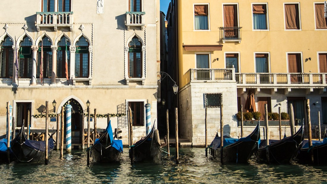 Gondolas are lined up along the banks of the Grand Canal.