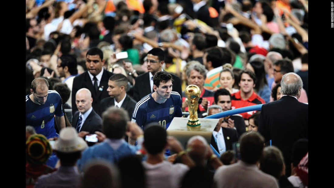 Argentina player Lionel Messi faces the World Cup trophy during the final celebrations at Maracana Stadium in Rio de Janeiro. His team lost to Germany 1-0, after a goal by Mario Götze in extra time.