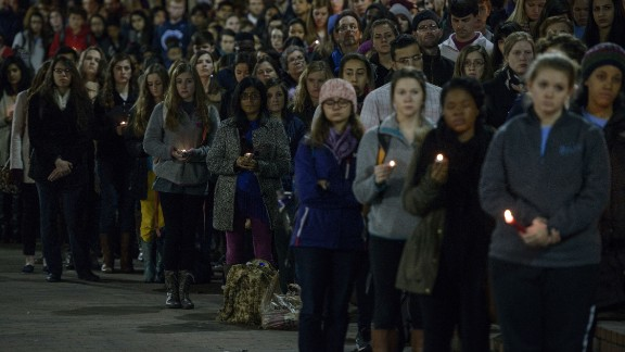 People attend a vigil at the Chapel Hill campus on February 11.