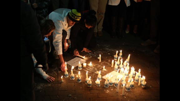People light candles to honor the victims on February 11.