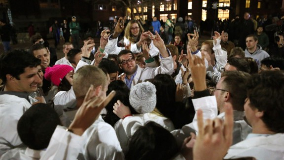 Dental students make the North Carolina State University Wolfpack sign following a candlelight vigil in Chapel Hill on February 11. One of the victims, Razan Mohammad Abu-Salha, was studying architecture at North Carolina State. Another, Deah Shaddy Barakat, was a second-year student at the University of North Carolina School of Dentistry. His wife, Yusor Mohammad, had recently been accepted to study there next year.