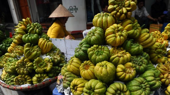"""A woman sells """"Buddha hand"""" fruits for Tet, or Vietnamese Lunar New Year, in downtown Hanoi, Vietnam, on February 12."""