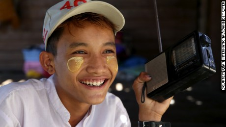 Than, a schoolboy in Myanmar, listens to the radio every morning for weather information and updates his teachers on potential storms.