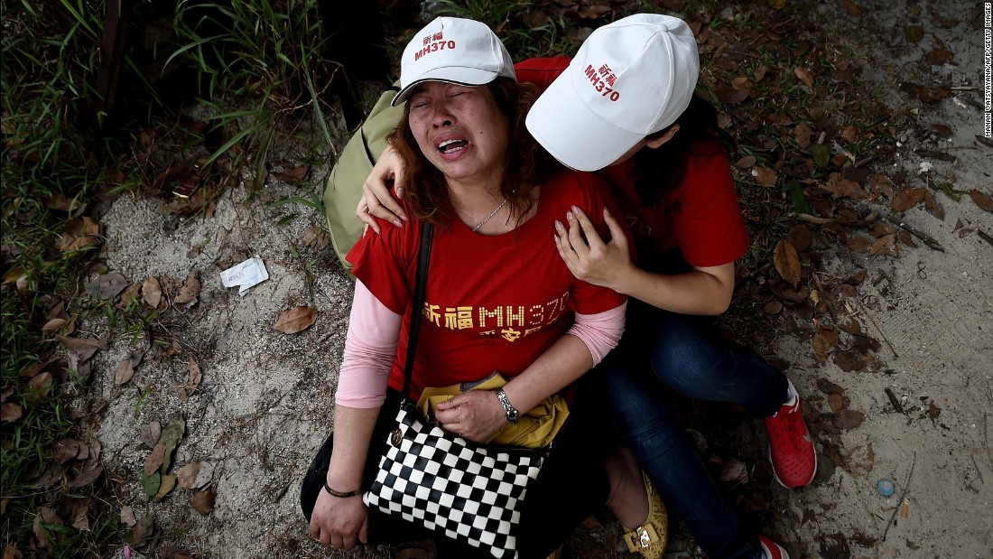 Relatives of the flight's passengers console each other outside the Malaysia Airlines office in Subang, Malaysia, on February 12, 2015. Protesters had demanded that the airline withdraw the statement that all 239 people aboard the plane were dead.
