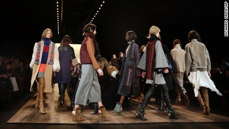 Models walk in the finale of the BCBG MAX AZRIA Fall 2015 collection during Fashion Week in New York, Thursday, Feb. 12, 2015. (AP Photo/Richard Drew/AP)