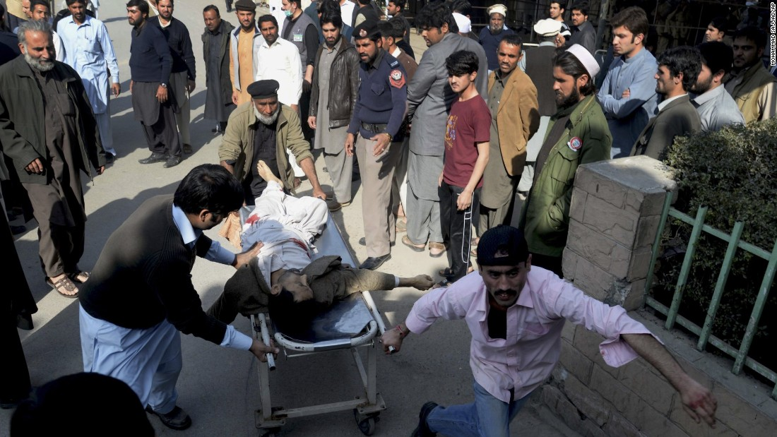 "An injured person gets rushed the hospital after an <a href=""http://www.cnn.com/2015/02/13/world/pakistan-violence/index.html"" target=""_blank"">attack on a Shiite Muslim mosque</a> Friday, February 13, in Peshawar in northwestern Pakistan. The Pakistan Taliban claimed responsibility for the suicide bombing and gunfire assault on the mosque that killed 19 people and injured dozens of others."