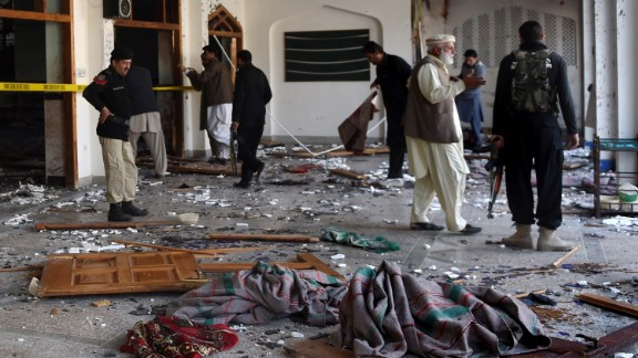 Pakistani security personnel inspect a Shiite Muslim mosque after an attack by Taliban militants in Peshawar on February 13, 2015. Grenade-toting Taliban militants stormed a Shiite mosque in northwest Pakistan, police said, in an attack that left at least 18 people dead.   AFP PHOTO / A MAJEED        (Photo credit should read A Majeed/AFP/Getty Images)