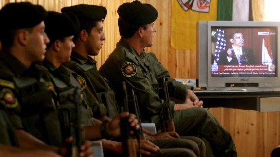 "Palestinian security forces in Jenin, West Bank, listen to Obama speak from Cairo University in Egypt in June 2009. The Palestinian Authority hailed as a ""good beginning"" Obama"