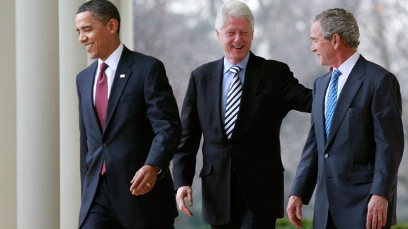 Obama and former Presidents Clinton and George W. Bush walk to the White House Rose Garden to speak about relief efforts for earthquake-stricken Haiti in January 2010.