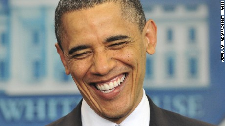 "Obama laughs as he makes a statement on his birth certificate in April 2011. Obama said he was bemused over conspiracy theories about his birthplace, and said the media's obsession with the ""sideshow"" issue was a distraction in a ""serious time."""
