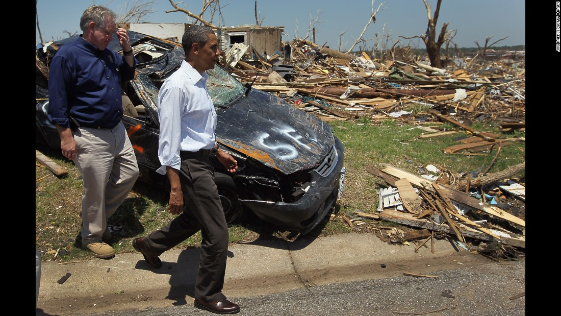 Obama and Missouri Gov. Jay Nixon walk together in May 2011 during a tour of the tornado devastation in Joplin, Missouri.