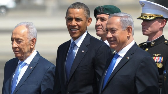 Israeli President Shimon Peres, left, and Prime Minister Benjamin Netanyahu, right, stand with Obama after Obama arrived in Tel Aviv, Israel, in March 2013.