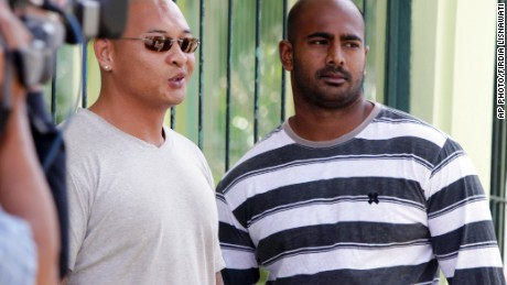 In this Aug. 17, 2011 file photo, Australian death-row prisoners Myuran Sukumaran, right and Andrew Chan, left, stand in front of their cell during an Indonesian Independence Day celebration at Kerobokan prison in Bali, Indonesia. Australia's Foreign Minister Julie Bishop on Thursday, Feb. 12, 2015 called on the Indonesian government to show the same mercy to two Australian drug traffickers on death row as Indonesia seeks from countries where Indonesian citizens face execution. (AP Photo/Firdia Lisnawati, File)