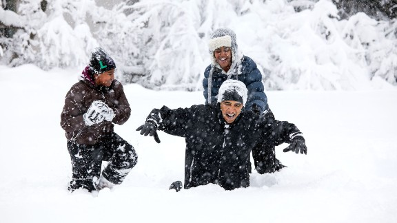 First daughters Sasha and Malia Obama play in the snow with their father after a snowstorm hit Washington in February 2010.