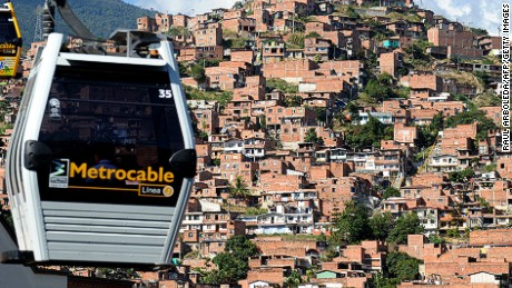 Picture taken of January 19, 2010, of Metrocable's gondolas in Medellin, Antioquia department, Colombia. Metrocable is a gondola lift system implemented by the City Council of Medellin, with the purpose of providing a complementary transportation service to that of Medellin's Metro. It was designed to reach some of the least developed suburban areas of Medellín. AFP PHOTO/Raul ARBOLEDA. (Photo credit should read RAUL ARBOLEDA/AFP/Getty Images