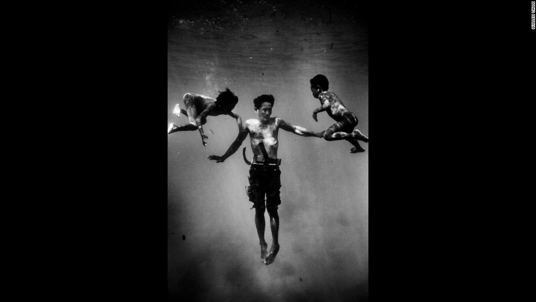 Photographer Guillem Valle took underwater portraits of them as part of a larger project about stateless people.