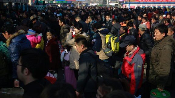 Chinese travelers queue up at the main entrance of the Beijing railway station in Beijing on Friday, February 13. Millions of Chinese were to travel to their hometowns to celebrate the Lunar New Year on February 19, marking the Year of the Sheep.