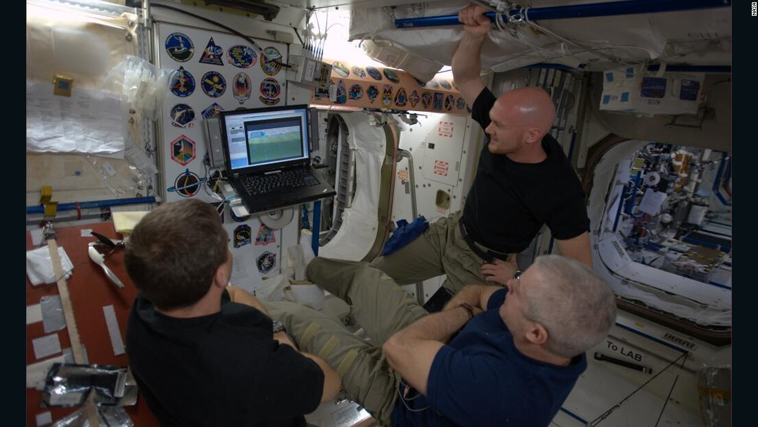 In June 2014, NASA astronauts Reid Wiseman and Steve Swanson and ESA astronaut Alexander Gerst take a break to watch the World Cup between science experiments aboard the International Space Station.